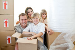 Loving family packing boxes royalty free stock photo