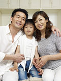 Loving family. Portrait of a family of three Royalty Free Stock Photography