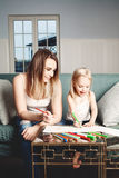 Loving Family. Woman and Child Drawing at Home Stock Photography