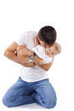 Loving father. Portrait of young father with his baby daughter Stock Image