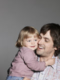 Loving Father Carrying Daughter Stock Photography