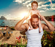 Loving father with daughter on shoulders Stock Photography