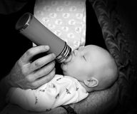 A loving father feeds his baby boy Stock Photo