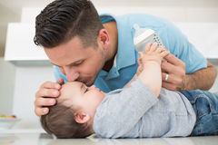 Loving father kissing baby on forehead royalty free stock images