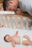 Loving father looking at cute baby royalty free stock photo