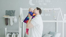 Loving father playing with joyful baby at home stock video
