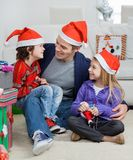 Loving Father With Siblings During Christmas Stock Image