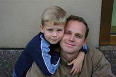 Loving Father and Son. Smiling Father and son hugging Royalty Free Stock Image