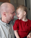 Loving Father and Son. Father is holding his toddler aged son and they are smiling at each other. Father and son are both lovingly looking at each other Stock Photos