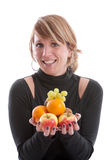 Loving fruit. Young modern woman with her hands full of fruit Royalty Free Stock Images