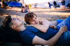 Loving gay couple. In field Stock Photos