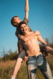 Loving gay couple. In field Royalty Free Stock Photography