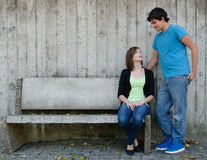 Loving Gaze. A loving gaze is shared between a teen couple with copyspace on the left Royalty Free Stock Images