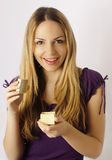 Loving the gift. Pretty blond young woman holding a gift and smiling royalty free stock photo