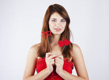 Loving girl with hearts wearing red dress. On a white background stock image