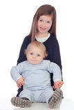 Loving girl taking care of her little brother Royalty Free Stock Photo