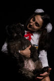 Loving glances. Woman with her black dog looking at eachother Royalty Free Stock Images