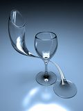 The loving glass. An enamoured glass circles another in a delicate embrace Royalty Free Stock Photography