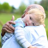 Loving grandfather holding his little grandchild Royalty Free Stock Images