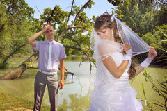 Loving groom is getting tired with his naughty bride Stock Photo