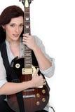 Loving the guitar Stock Image