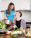 Loving guy and  girl cooking Royalty Free Stock Photos