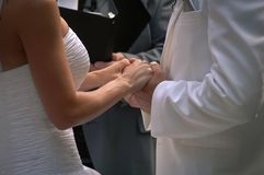 Loving Hands. Bridal couple at a wedding ceremony holding hands Royalty Free Stock Photography