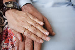 Loving hands. Wedding photo of married couple holding hands Royalty Free Stock Images