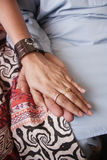 Loving hands. Wedding photo of married couple holding hands Royalty Free Stock Image