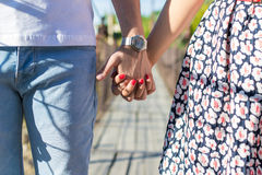 A loving  hands. A loving young couple holding hands Royalty Free Stock Images