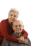 Loving, handsome senior couple. Handsome senior couple on a white background Stock Photo