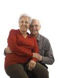 Loving, handsome senior couple. Handsome senior couple on a white background Royalty Free Stock Photo