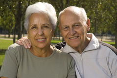 Loving, handsome senior couple. Relaxing in the park Royalty Free Stock Photo