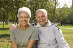 Loving, handsome senior couple. Relaxing in the park Royalty Free Stock Image