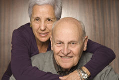Loving, handsome senior couple Stock Photos
