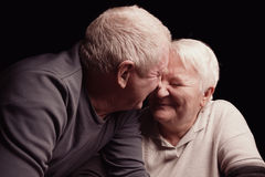 Happy older pair on a black background Stock Photo