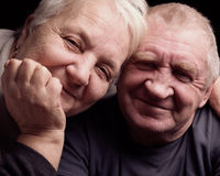 Happy older pair on a black background Stock Image