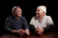 Happy older pair on a black background Royalty Free Stock Photography