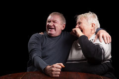 Happy older pair on a black background Stock Photos