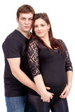Loving happy couple, pregnant woman with her husband, isolated o Stock Photo