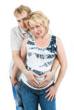 Loving happy couple, pregnant woman with her husband, isolated on white Royalty Free Stock Images