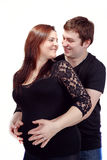 Loving happy couple, smiling pregnant woman with her husband Royalty Free Stock Photos