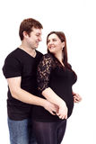 Loving happy couple, smiling pregnant woman with her husband Stock Photos