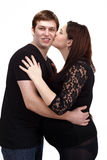 Loving happy couple, woman kissing her husband Stock Images