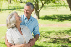 Loving and happy mature couple at park Royalty Free Stock Images