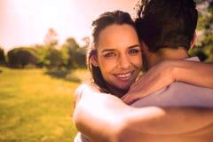Loving and happy woman embracing man at park vector illustration