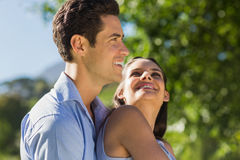 Loving and happy young couple at park Royalty Free Stock Photography
