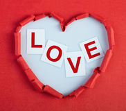 Loving heart. Paper heart with graved capton love in it Royalty Free Stock Images