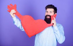 Loving heart. Valentines man expressing love on 14 february. Love sickness and heart problems. Bearded man holding big. Red heart. Having heart attack and stock images