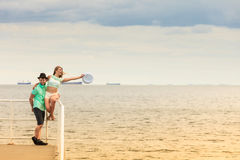 Loving hipster couple on sea pier Royalty Free Stock Photo